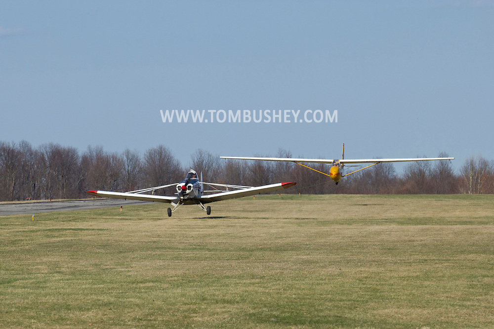 Middletown, New York - A plane tows a glider into the air at Randall Airport on April 12, 2014.