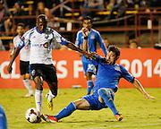 San Jose Earthquakes defender Dan Gargan (3) tackles Montreal Impact midfielder Sanna Nyassi (11) in the second half of the game at Buck Shaw Stadium in Santa Clara, California, on September 17, 2013.  The San Jose Earthquakes beat Montreal Impact 3-0. (Stan Olszewski/QMI Agency)