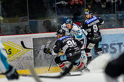 01.01.2019, Ice Rink, Znojmo, CZE, EBEL, HC Orli Znojmo vs EHC Liwest Black Wings Linz, 34. Runde, im Bild v.l. Ryan Kujawinski (HC Orli Znojmo) Corey Locke (EHC Liwest Black Wings Linz) Allan McPherson (HC Orli Znojmo) // during the Erste Bank Eishockey League 34th round match between HC Orli Znojmo and EHC Liwest Black Wings Linz at the Ice Rink in Znojmo, Czechia on 2019/01/01. EXPA Pictures © 2019, PhotoCredit: EXPA/ Rostislav Pfeffer