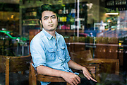 HANOI, VIETNAM – JUNE 29, 2017: A portrait of Nguyen Anh Tuan, 27, a human rights activist and supporter of freedoms of expression in Vietnam since 2011. He works with VOICE, Vietnamese Overseas Initiative for Conscience Empowerment, a group working to promote civil society.