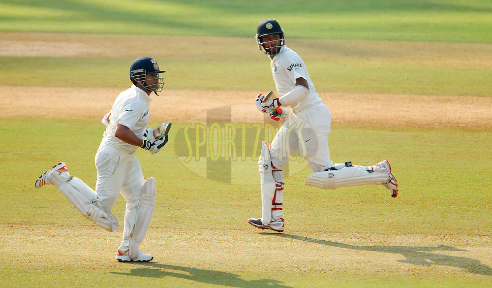 Sachin Tendulkar of India and Cheteshwar Pujara of India  during day one of the second Star Sports test match between India and The West Indies held at The Wankhede Stadium in Mumbai, India on the 14th November 2013<br /> <br /> This test match is the 200th test match for Sachin Tendulkar and his last for India.  After a career spanning more than 24yrs Sachin is retiring from cricket and this test match is his last appearance on the field of play.<br /> <br /> <br /> Photo by: Ron Gaunt - BCCI - SPORTZPICS<br /> <br /> Use of this image is subject to the terms and conditions as outlined by the BCCI. These terms can be found by following this link:<br /> <br /> http://sportzpics.photoshelter.com/gallery/BCCI-Image-Terms/G0000ahUVIIEBQ84/C0000whs75.ajndY