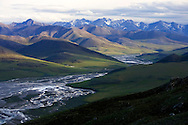 View of the Kongakut River Valley, looking south towards the Brooks Mountain Range over Caribou Pass at midnight