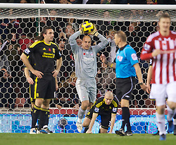 STOKE, ENGLAND - Saturday, November 13, 2010: Liverpool's Sotirios Kyrgiakos and goalkeeper Jose Reina look dejected after his side concede Stoke City's opening goal during the Premiership match against Stoke City at the Britannia Stadium. (Photo by David Rawcliffe/Propaganda)