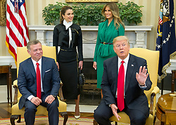 United States President Donald J. Trump asks for the press to stay as he makes a statement on Syria as he meets King Abdullah II of Jordan in the Oval Office of the White House in Washington, DC on Wednesday, April 5, 2017.  Standing behind the President and  King are Queen Rania of Jordan, left, and first lady Melania Trump, right.<br /> Credit: Ron Sachs / Pool via CNP *** Please Use Credit from Credit Field ***