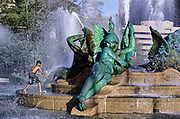 Boy playing in Swann Fountain in Logan's Circle, Philadelphia, Pennsylvania