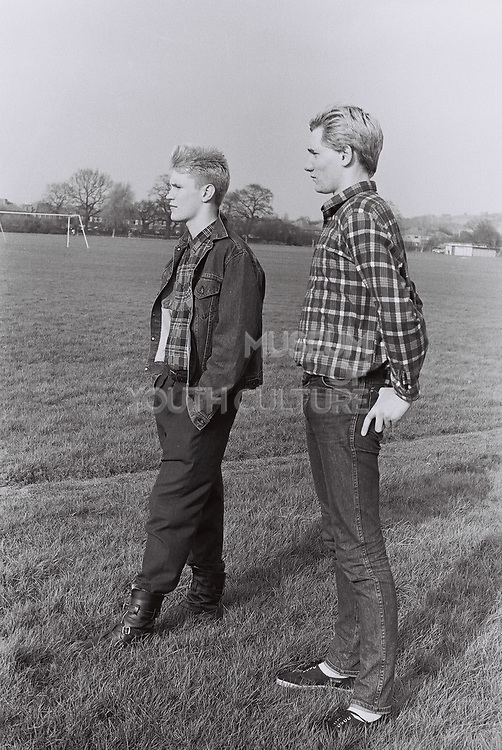 Teenagers posing on a football field, London, UK, 1983