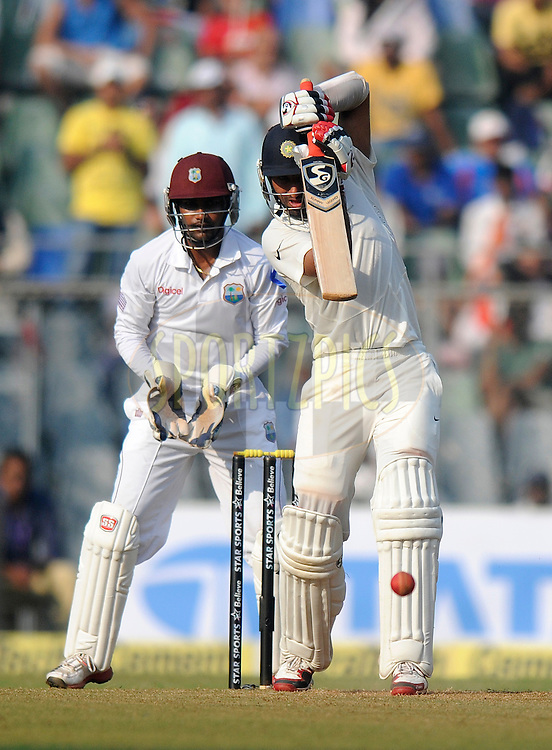 Cheteshwar Pujara of India bats during day one of the second Star Sports test match between India and The West Indies held at The Wankhede Stadium in Mumbai, India on the 14th November 2013<br /> <br /> This test match is the 200th test match for Sachin Tendulkar and his last for India.  After a career spanning more than 24yrs Sachin is retiring from cricket and this test match is his last appearance on the field of play.<br /> <br /> Photo by: Pal PIllai - BCCI - SPORTZPICS<br /> <br /> Use of this image is subject to the terms and conditions as outlined by the BCCI. These terms can be found by following this link:<br /> <br /> http://sportzpics.photoshelter.com/gallery/BCCI-Image-Terms/G0000ahUVIIEBQ84/C0000whs75.ajndY