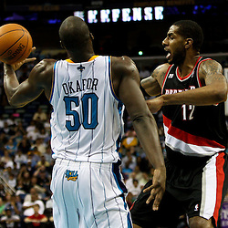 March 30, 2011; New Orleans, LA, USA;Portland Trail Blazers power forward LaMarcus Aldridge (12) loses the ball as New Orleans Hornets center Emeka Okafor (50) defends during the third quarter at the New Orleans Arena. The Hornets defeated the Trail Blazers 95-91.   Mandatory Credit: Derick E. Hingle