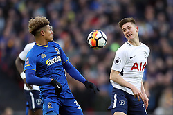 AFC Wimbledon's Lyle Taylor (left) and Tottenham Hotspur's Juan Foyth battle for the ball during the Emirates FA Cup, Third Round match at Wembley Stadium, London.