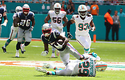 Sep 15, 2019; Miami Gardens, FL, USA;  New England Patriots wide receiver Antonio Brown (17) runs for yardage after officially making his first catch as a Patriot against the Miami Dolphins during an NFL game at Hard Rock Stadium in Miami Gardens, FL. The Patriots beat the Dolphins 43-0. (Steve Jacobson/Image of Sport)