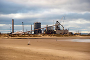 The beach at Redcar in the North East of England with an industrial plant in the background.
