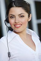 Female office worker wearing headset, portrait