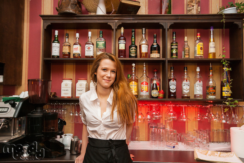 Portrait of confident female bartender at counter