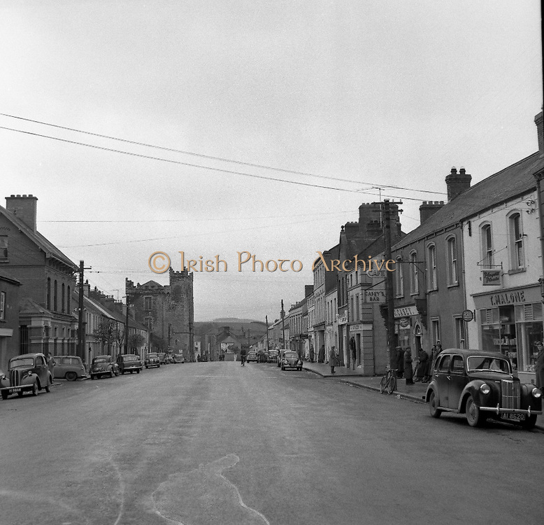 Towns in Ireland, Main Street Ardee, Co. Louth.04/04/1957 <br /> Ardee at the north of the pale where you have a street called Irish Street the town was occupied by non Irish!