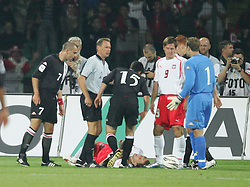 WARSAW, POLAND - WEDNESDAY, SEPTEMBER 7th, 2005: Wales' players surround Poland's Kamil Kosowski who went down for a penalty during the World Cup Group Six Qualifying match at the Legia Stadium. (Pic by David Rawcliffe/Propaganda)