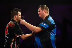 Kevin Munch, right congratulated Toni Alcinas on his victory  during day eleven of the William Hill World Darts Championship at Alexandra Palace, London. PRESS ASSOCIATION Photo. Picture date: Wednesday December 27, 2017. See PA story DARTS World. Photo credit should read: John Walton/PA Wire. RESTRICTIONS: Use subject to restrictions. Editorial use only. No commercial use.