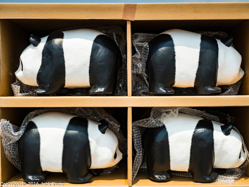 """04 MARCH 2016 - BANGKOK, THAILAND:  Boxed paper maché pandas ready to be set for the """"1600 Pandas+ World Tour in Thailand: For the World We Live In and the Ones We Love"""" exhibit Friday at Sanam Luang in Bangkok. The 1600 paper maché pandas, an art installation by French artist Paulo Grangeon will travel across Bangkok and parts of central Thailand for the next week and then will be displayed at Central Embassy, a Bangkok shopping mall, until April 10. The display of pandas in Thailand is benefitting World Wide Fund for Nature - Thailand and is sponsored by Central Embassy with assistance from the Tourism Authority of Thailand and Bangkok Metropolitan Administration and curated by AllRightsReserved Ltd.      PHOTO BY JACK KURTZ"""