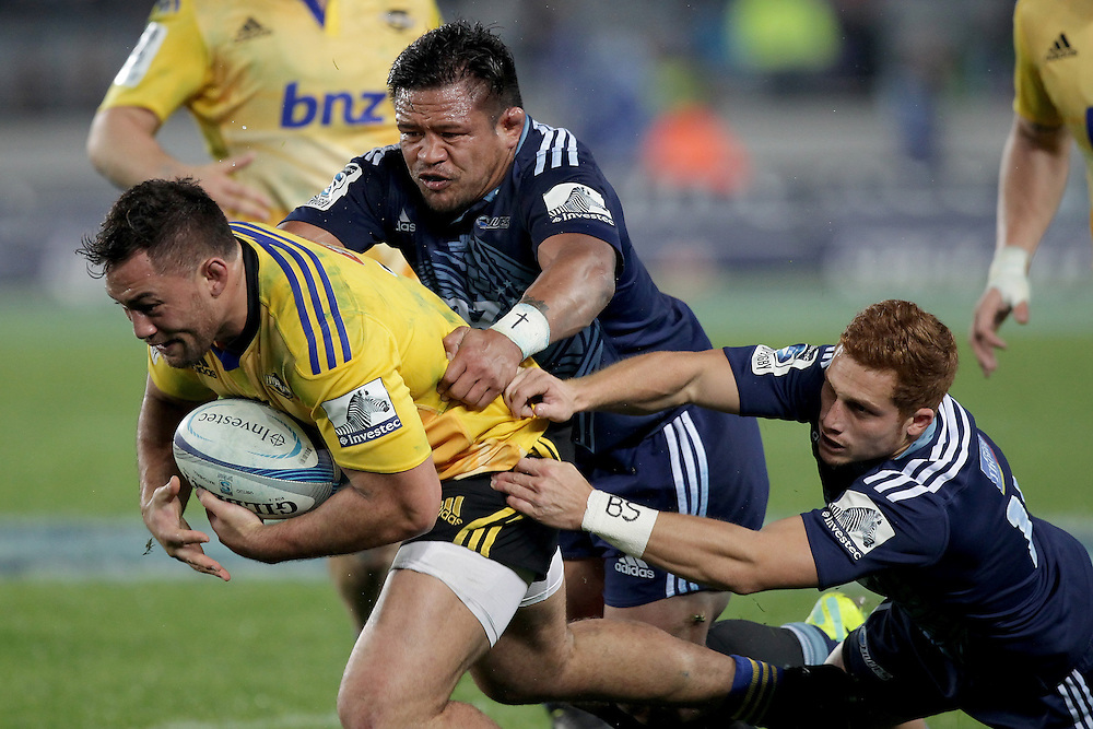 Hurricanes' Jack Lam is tackled by by Blues' Keven Mealamu and Ihaia West in a Super Rugby match, Eden Park, Auckland, New Zealand, Saturday, May 31, 2014.  Credit:SNPA / David Rowland