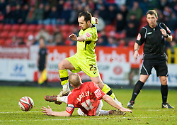 LONDON, ENGLAND - Saturday, January 30, 2010: Charlton Athletic's Nicky Bailey sticks out a foot to stop the run of Tranmere Rovers' Chris Shuker during the Football League One match at the Valley. (Photo by Gareth Davies/Propaganda)