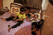 Sagar (10, right) plays a game with his friends Ali and Juneid.