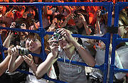 Fans push up against the 'cage' to get a glimpse of Japanese soccer star Junichi Inamoto at NikePark, Harajuku, Tokyo. Promotion for Japan FIFA World Cup 24/06/02..©David Dare Parker/AsiaWorks Photography