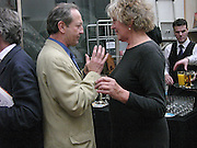 Dan Topolski and Germaine Greer, 1812 Napoleon's Fatal March on Moscow by Adam Zamoyski book launch. Avenue Studios. Fulham Rd. 5 April 2004. ONE TIME USE ONLY - DO NOT ARCHIVE  © Copyright Photograph by Dafydd Jones 66 Stockwell Park Rd. London SW9 0DA Tel 020 7733 0108 www.dafjones.com