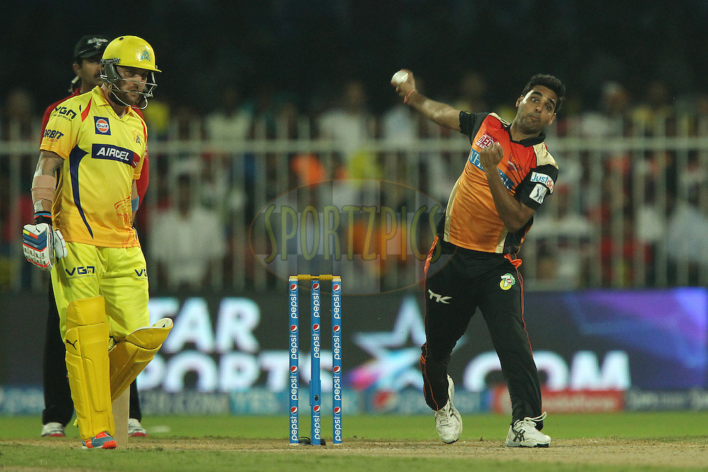 Bhuvneshwar Kumar of the Sunrisers Hyderabad bowls as Brendon McCullum of The Chennai Superkings looks on during match 17 of the Pepsi Indian Premier League 2014 between the Sunrisers Hyderabad and the Chennai Superkings held at the Sharjah Cricket Stadium, Sharjah, United Arab Emirates on the 27th April 2014<br /> <br /> Photo by Ron Gaunt / IPL / SPORTZPICS