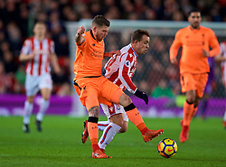 STOKE-ON-TRENT, ENGLAND - Wednesday, November 29, 2017: Liverpool's Alberto Moreno dispossess Stoke City's Xherdan Shaqiri during the FA Premier League match between Stoke City and Liverpool at the Bet365 Stadium. (Pic by David Rawcliffe/Propaganda)
