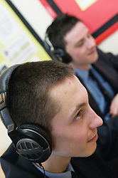 Secondary school students learning languages using headphones,
