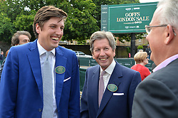 Left to right, JAKE WARREN and his father JOHN WARREN HM The Queen's Racing Manager at Goffs London Sale held at The Orangery, Kensington Palace, London on 15th June 2015.
