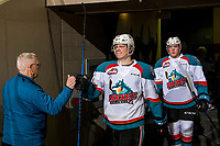 KELOWNA, CANADA - JANUARY 16:  Dallon Wilton #15 of the Kelowna Rockets fist bumps an usher on his way to the ice for second period against the Moose Jaw Warriors on January 16, 2019 at Prospera Place in Kelowna, British Columbia, Canada.  (Photo by Marissa Baecker/Shoot the Breeze)