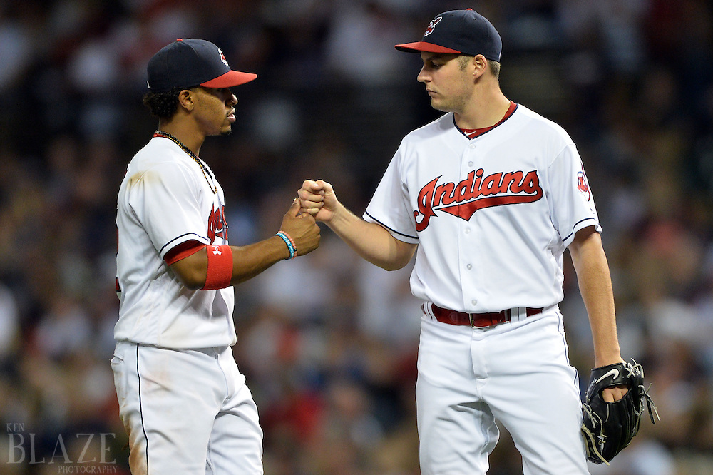 Sep 3, 2016; Cleveland, OH, USA; Cleveland Indians shortstop Francisco Lindor (12) and Cleveland Indians starting pitcher Trevor Bauer (47) celebrate during the ninth inning against the Miami Marlins at Progressive Field. Mandatory Credit: Ken Blaze-USA TODAY Sports