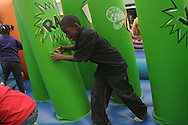 Sean Bonny climbs through a tunnel during the Lafayette Elementary carnival Friday, April 23, 2010 in Oxford, Miss.