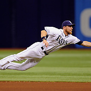 Tampa Bay Rays second baseman Ben Zobrist (18) makes a diving catch on a line drive hit by Seattle Mariners third baseman Kyle Seager (15) during the fourth inning Monday, June 9, 2014 in St. Petersburg.