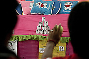 Red shirts militants are trying to target cans pictured with the prime minister Abbhisit portrait in the camp of Ratchaprasong in Bangkok. The king was never depitced, any critic can be punisheb with 15 years of jail.