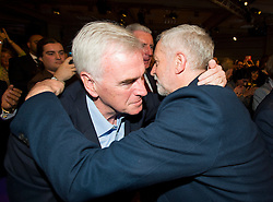 © Licensed to London News Pictures. 12/09/2015. London, UK. JEREMY CORBYN hugging his close friend JOHN MCDONNELL (Member of Parliament for Hayes and Harlington) after the announcement.    The announcement of the new leader of the Labour Party at the QEII centre in Westminster, London on September 12, 2015. Former leader ED Miliband resigned after a heavy defeat at the last election. Photo credit: Ben Cawthra/LNP