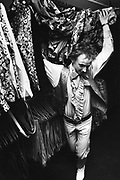 Man in wardrobe of psychedelic clothes, The Regal, UK, 1980's.