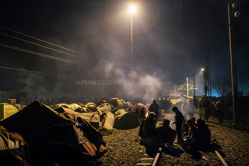 Idomeni railway station at night. More than 10k refugees are living in small tents and the ruins of an old railway station in Idomeni (Greece). The camp stretches out for hundreds of meters along the railway tracks that cross the border between Greece and FYROM (Macedonia)