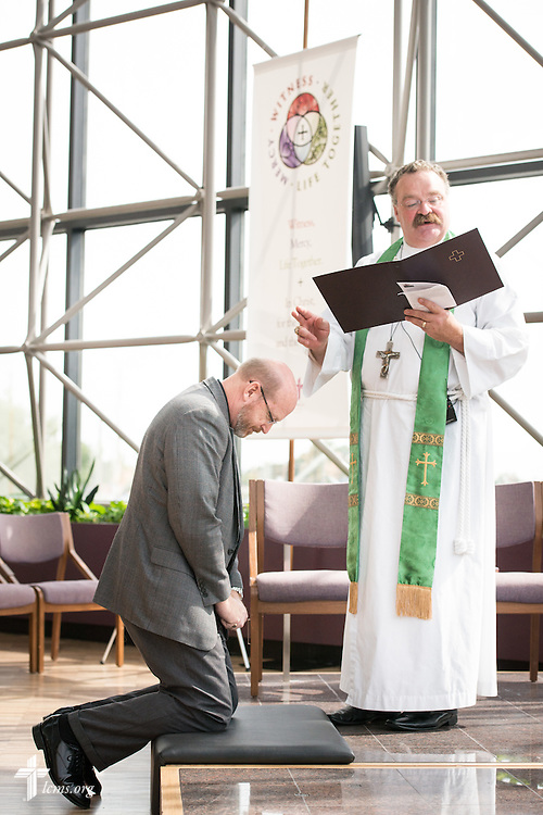 The Rev. Dr. Matthew C. Harrison, president of The Lutheran Church–Missouri Synod, installs the Rev. Mark Wood, director of Witness and Outreach Ministry in Office of National Mission, in the International Center chapel of The Lutheran Church–Missouri Synod on Wednesday, Sept. 3, 2014, in Kirkwood, Mo. LCMS Communications/Erik M. Lunsford