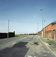 A deserted street in a rundown area known as the Dingle in Liverpool, by the river Mersey. The Mersey is a river in north west England which stretches for 70 miles (112 km) from Stockport, Greater Manchester, ending at Liverpool Bay, Merseyside. For centuries, it formed part of the ancient county divide between Lancashire and Cheshire.