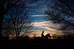 A jockey and horse head out to the track before the Racing TV Apprentice handicap stakes at Kempton Park Racecourse, Esher.