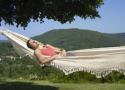 Jul. 10, 2008 - Girl asleep in hammock. Model Released (MR) (Credit Image: © Cultura/ZUMAPRESS.com)