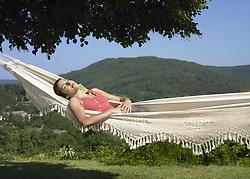 Jul. 10, 2008 - Girl asleep in hammock. Model Released (MR) (Credit Image: © Cultura/ZUMAPRESS.com)