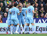Picture by Andrew Timms/Focus Images Ltd. 07917 236526.14/04/12.Carlos Tevez, Samir Nasri & Gareth Barry of Manchester City celebrate Man City's first goal during the Barclays Premier League match against Norwich City at Carrow Road stadium, Norwich.