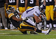 October 15, 2011: Northwestern Wildcats wide receiver Jeremy Ebert (11) is pulled down by Iowa Hawkeyes cornerback Micah Hyde (18) during the second half of the NCAA football game between the Northwestern Wildcats and the Iowa Hawkeyes at Kinnick Stadium in Iowa City, Iowa on Saturday, October 15, 2011. Iowa defeated Northwestern 41-31.