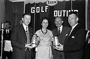 14/05/1965<br /> 05/14/1965<br /> 14 May 1965<br /> Esso Golf Outing at Woodbrook Golf Club, Bray, Co. Wicklow. Mrs J.H. Donovan, wife of the Managing Director of Esso, presenting the Mens 12 Hole Foursomes prize to Mr Raymond Behan (left) and Mr Michael Tanham.