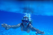 A young woman makes bubbles while swimming underwater, 96. Model released. Photo: Chris Cole/Action Plus<br /> <br /> <br /> 1996 release<br /> leisure activities<br /> pastime<br /> pastimes<br /> swimming<br /> swim<br /> swimmer<br /> swimmers<br /> exercise<br /> exercising<br /> water sport<br /> water sports<br /> watersport<br /> watersports