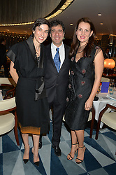 Left to right, ALEXANDRA JEFFORD, HOSSEIN AMINI and DANA HOEGH at a dinner hosted by AA Gill & Nicola Formby in support of the Borne charity held at Rivea at the Bulgari Hotel, Knightsbridge, London on 3rd February 2015.