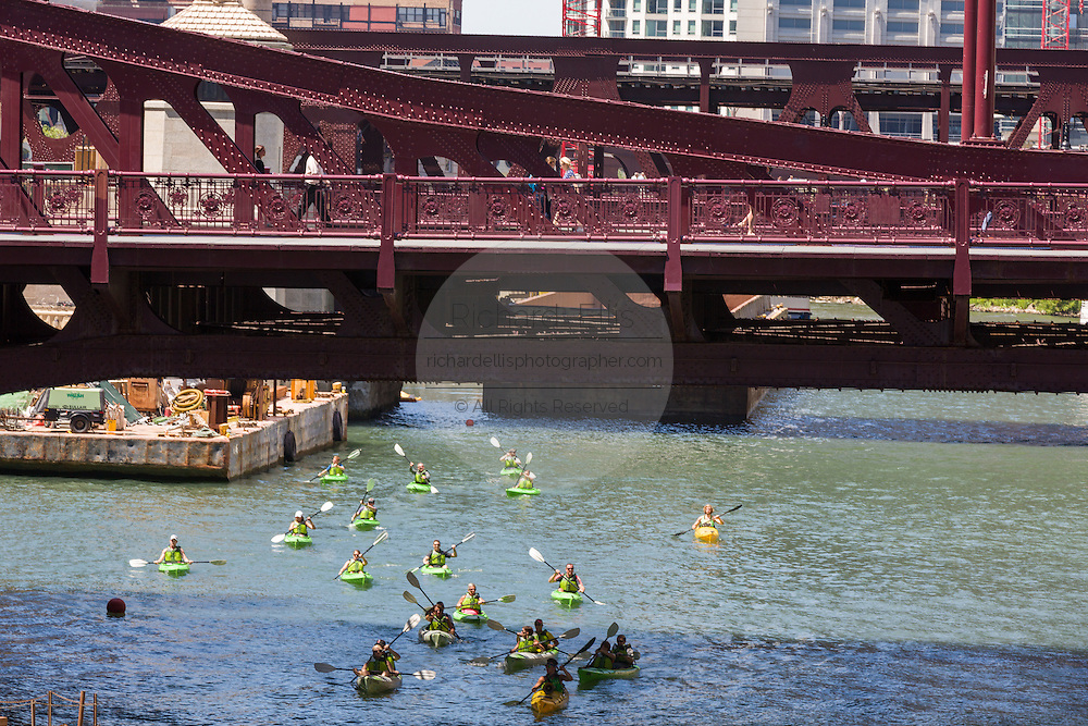 Kayakers on the Chicago River with the Irv Kupcinet Bridge on a summers day in Chicago, Illinois, USA