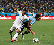 Edinson Cavani of Uruguay and Raheem Sterling of England during the 2014 FIFA World Cup match at Arena Corinthians, Sao Paulo<br /> Picture by Andrew Tobin/Focus Images Ltd +44 7710 761829<br /> 19/06/2014